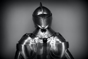 Grayscale photography of a medieval knight's armor.